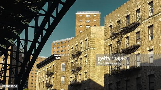 residential buildings as seen from under the riverside drive viaduct, at 125th street and 12th avenue, harlem, manhattan - harlem stock pictures, royalty-free photos & images