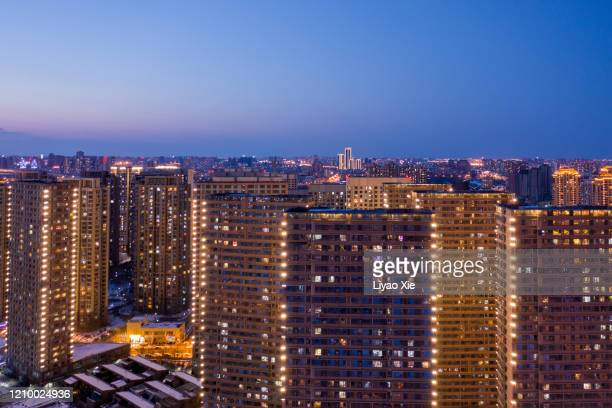 residential buildings at night - liyao xie stock pictures, royalty-free photos & images