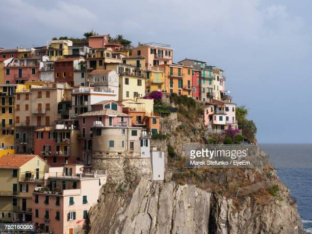 residential buildings by sea against sky - marek stefunko stock pictures, royalty-free photos & images