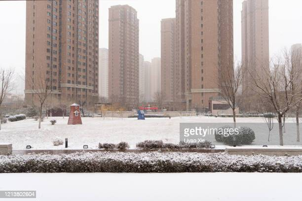 residential buildings in snow - liyao xie stock pictures, royalty-free photos & images
