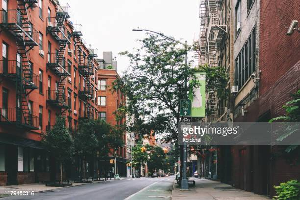 residential buildings in soho district , new york - soho new york stock pictures, royalty-free photos & images