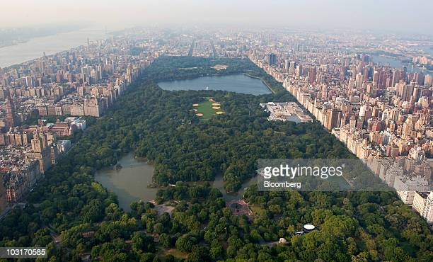 Residential buildings line Central Park in this aerial photo taken over New York US on Wednesday July 7 2010 New York City the thirdlargest US...