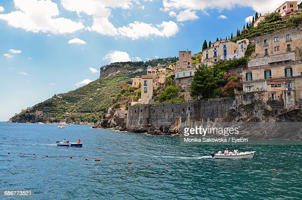 Residential Buildings On Mountains By Sea Against Sky At Minori