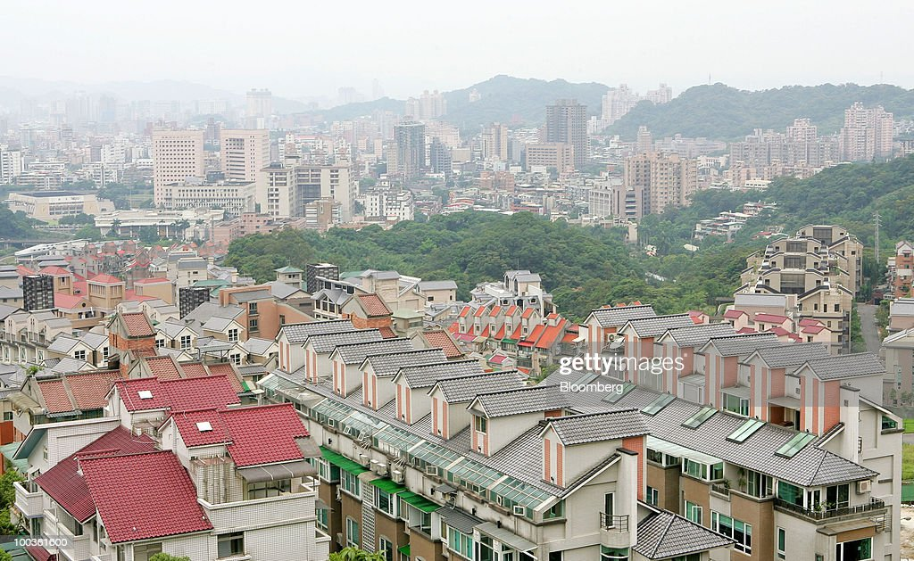 Residential buildings rise out of the skyline in this elevated view of Taipei, Taiwan, on Saturday, May 22, 2010. Investors should sell Taipei property now, taking advantage of a 21-month rally in prices before the government acts to make real estate more affordable, according to the Taiwan Real Estate Research Center and the island's largest real-estate brokerage. Photographer: Maurice Tsai/Bloomberg via Getty Images