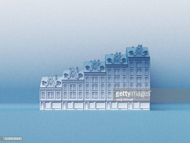 residential buildings shaped like a rising bar graph - mortgage stock pictures, royalty-free photos & images