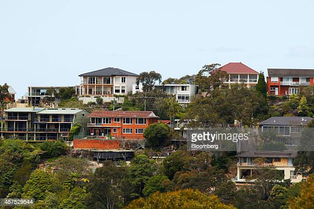 Residential buildings sit among trees on a hill in the suburb of Castle Cove in Sydney Australia on Saturday Oct 18 2014 Sydneys median home price...
