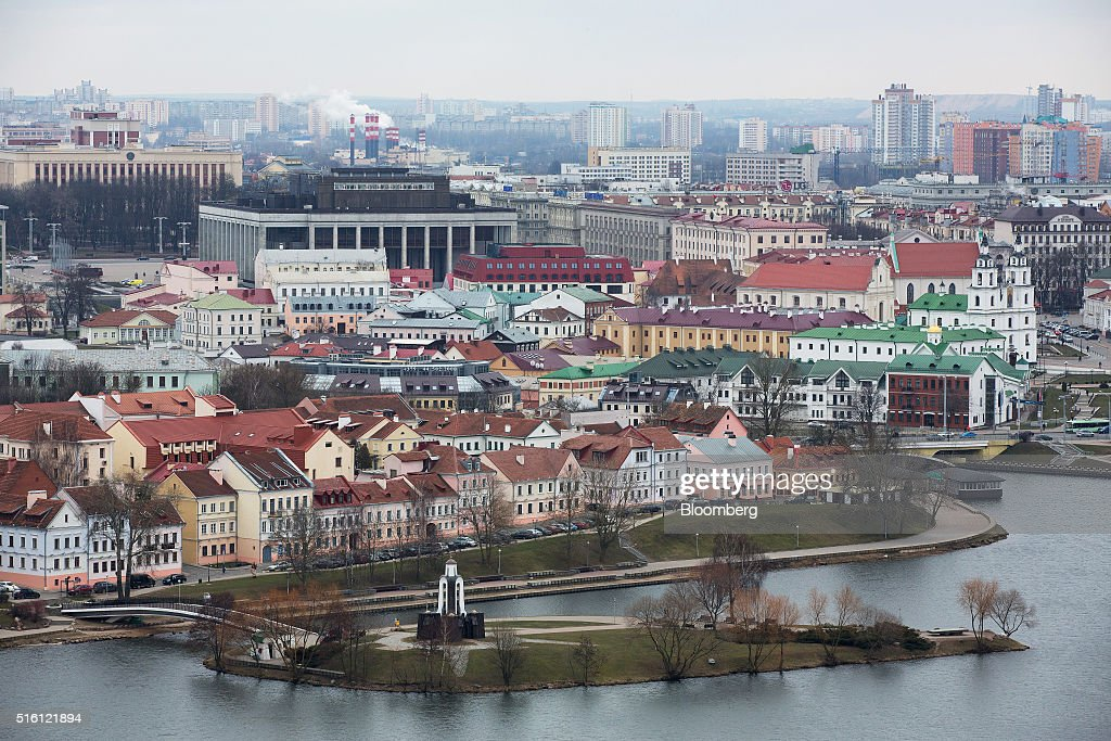 Residential buildings sit beside the Svislach River in the old town, also known as Trinity suburb, in Minsk, Belarus, on Wednesday, March 16, 2016. European Union governments scrapped sanctions on leaders of Belarus in an effort to pry the former Soviet republic out of the shadow of the Kremlin. Photographer: Andrey Rudakov/Bloomberg via Getty Images