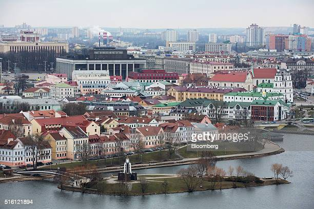 Residential buildings sit beside the Svislach River in the old town also known as Trinity suburb in Minsk Belarus on Wednesday March 16 2016 European...
