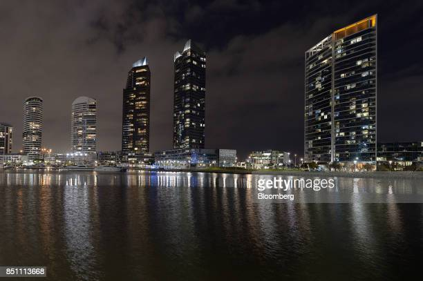 Residential buildings stand at night in the Docklands area of Melbourne Australia on Thursday July 20 2017 Melbournes tax of 1 percent of an empty...
