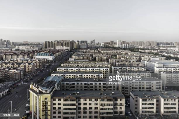 Residential buildings stand in Baotou, Inner Mongolia, China, on Friday, Aug. 11, 2017. China's economy showed further signs of entering a...