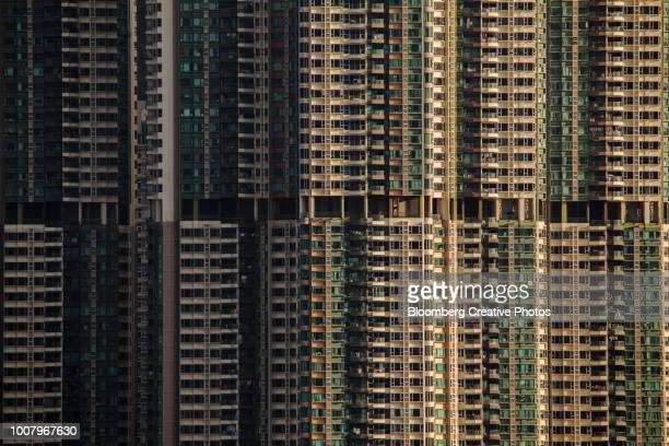 residential buildings stand in hong kong - hong kong stock pictures, royalty-free photos & images