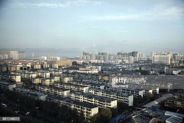 Residential buildings stand in Qinhuangdao Hebei province China on Friday Oct 28 2016 China's top overseas bond fund said Chinese property dollar...