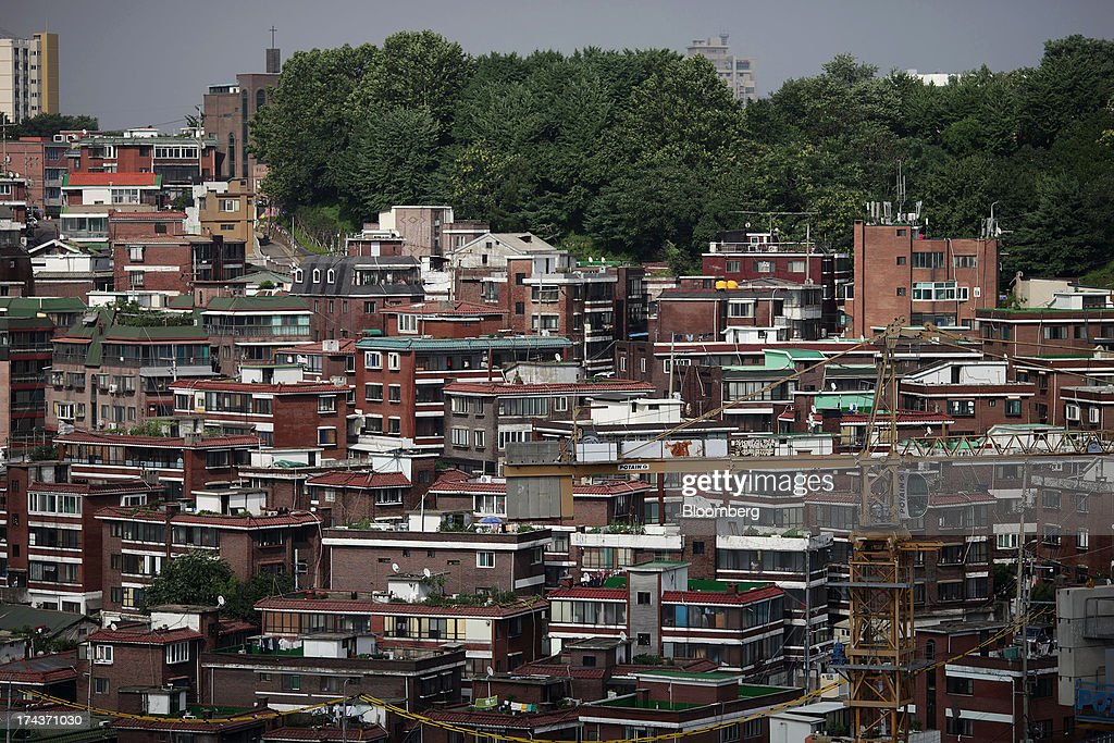 Residential buildings stand in the district of Mapo in Seoul, South Korea, on Wednesday, July 24, 2013. South Koreas economy grew the most in more than two years, on stronger government spending and private consumption even as a slowdown in China clouds the outlook. Photographer: Woohae Cho/Bloomberg via Getty Images