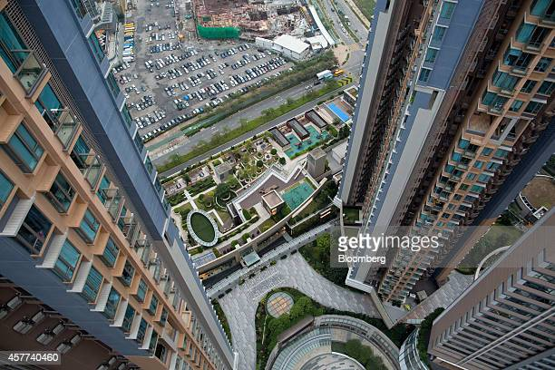Residential buildings stand in the Tseung Kwan O district of Hong Kong China on Thursday Oct 23 2014 Hong Kong is scheduled to release private...