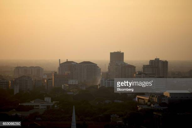 Residential buildings stand in Yangon Myanmar on Saturday March 11 2017 Myanmar is considering changes to the companies law that would allow foreign...