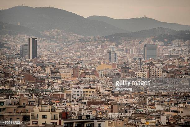 Residential buildings stand on the city skyline in Barcelona Spain on Friday Feb 21 2014 A smart city initiative which also involves rolling out...