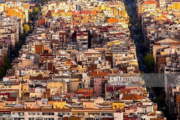 Residential buildings stand on the city skyline on April 10 2015 in Barcelona Spain Barcelona's city hall has put a regulation in motion that bans...