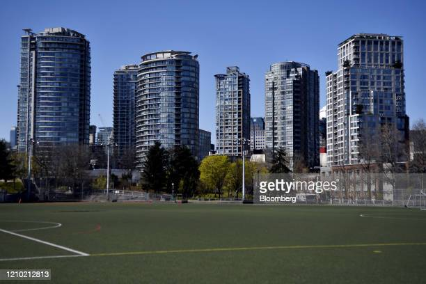 Residential buildings stand past an empty playing field in Vancouver British Columbia Canada on Thursday April 16 2020 As its oil sector shriveled in...