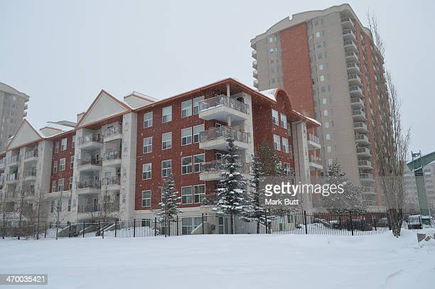 Residential buildings surround around the Railtown Park in downtown Edmonton.