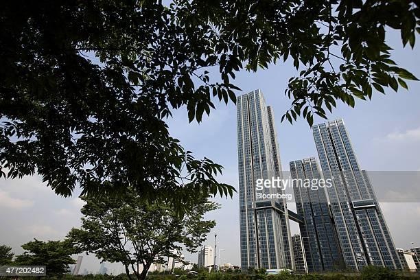 Residential buildings under construction developed by Samsung CT Corp right stand in the Seocho district of Seoul South Korea on Sunday June 14 2015...