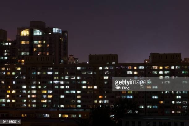 residential buildings with lights in night, Beijing