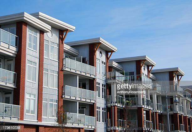 Residential condos photographed against blue sky