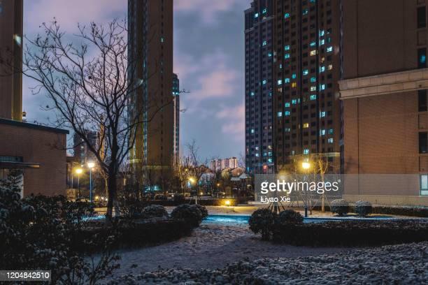 residential district after snow at night - liyao xie stock-fotos und bilder