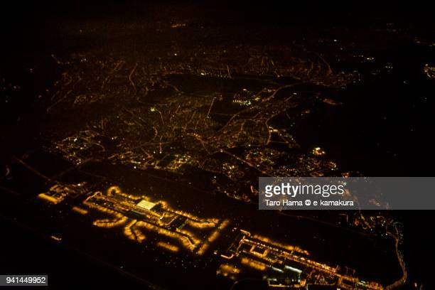 residential district and changi airport in singapore, night time aerial view from commercial airplane - チャンギ空港 ストックフォトと画像
