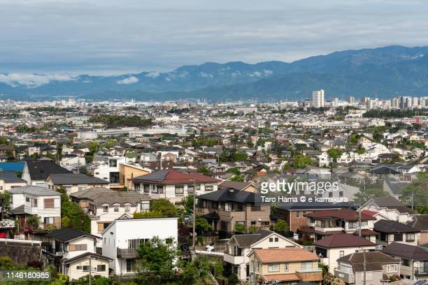 residential district and mountains in japan - 東海地方 ストックフォトと画像