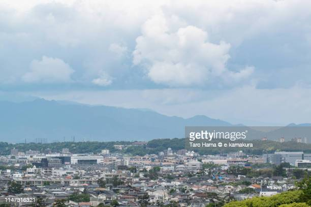 residential district and mountains in japan - chigasaki stock pictures, royalty-free photos & images