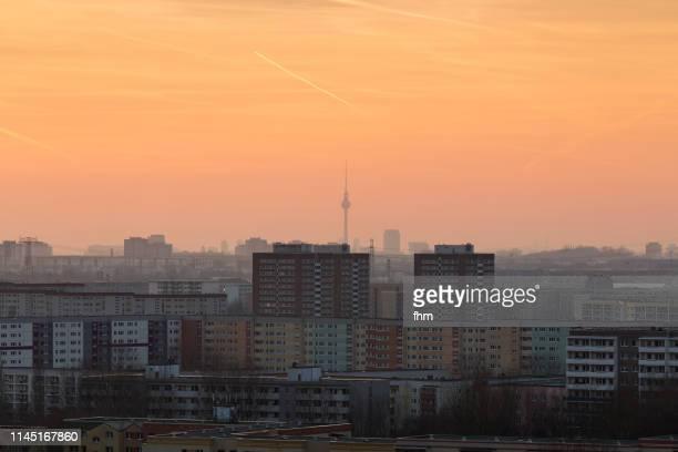 residential district berlin marzahn with famous landmark tv-tower in the background - smog stock-fotos und bilder