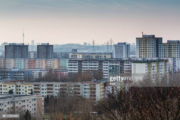 residential district berlin marzahn with famous landmark tv-tower in the background - central berlin stock photos and pictures