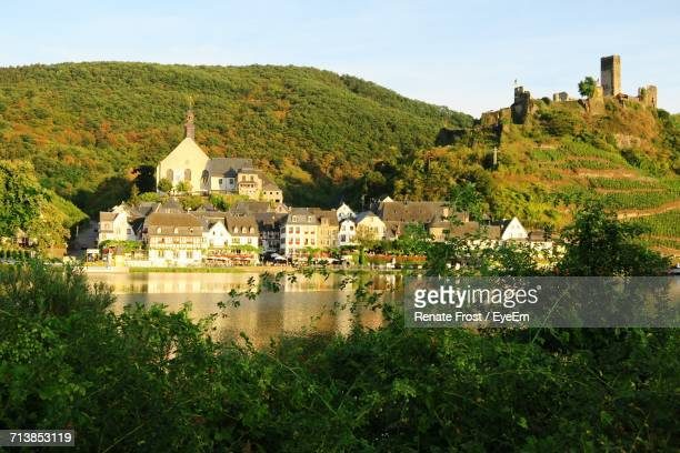 Residential District By Moselle River Against Mountain