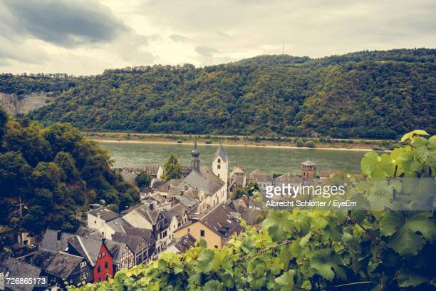 Residential District By Rhine River Against Cloudy Sky