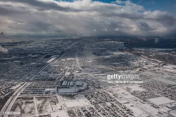 Residential district in Tomakomai city in Hokkaido in Japan daytime aerial view from airplane