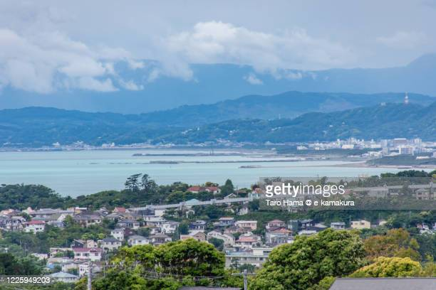 residential districts by the coral-colored sea in kanagawa prefecture of japan - chigasaki stock pictures, royalty-free photos & images