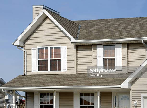 residential home with vinyl siding, gable roof, seamless gutters, shutters - rooftop stock pictures, royalty-free photos & images