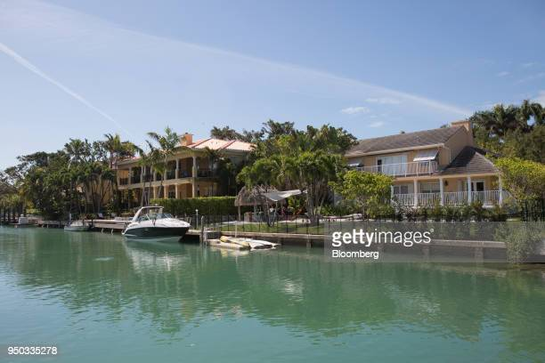 Residential homes sit along the water in Key Biscayne, Florida, U.S., on Thursday, April 19, 2018. Around the country, the government's response to...