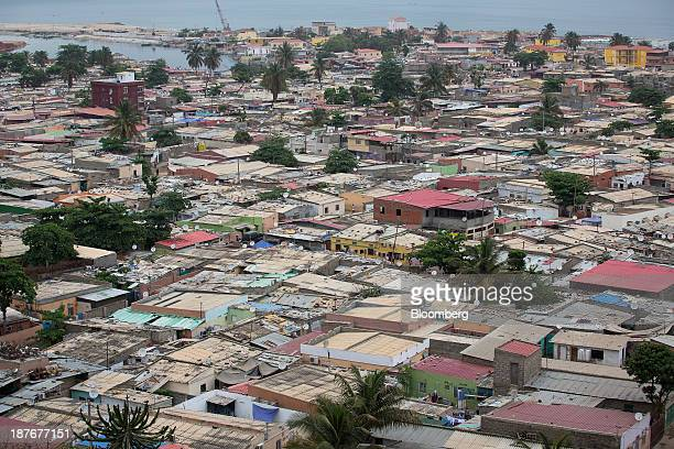 Residential homes stand in a shanty town on the Atlantic shoreline in Luanda, Angola, on Friday, Nov. 8, 2013. Angola, the largest crude oil producer...