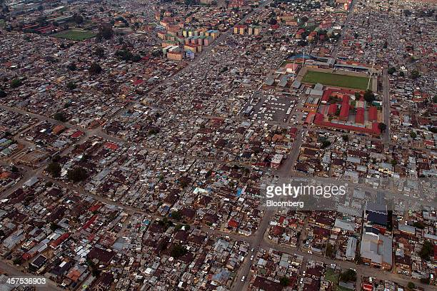 Residential homes stand in the Alexandra township district of Gauteng province in this aerial view of Johannesburg South Africa on Saturday Dec 14...