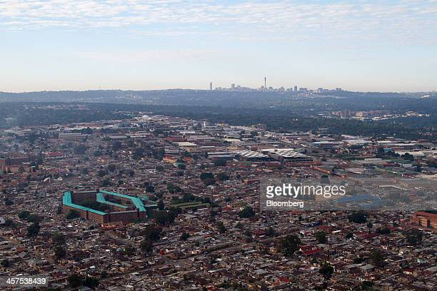 Residential homes surround the workers hostel left in the Alexandra township district of Gauteng province beyond the Hillbrow district top in this...