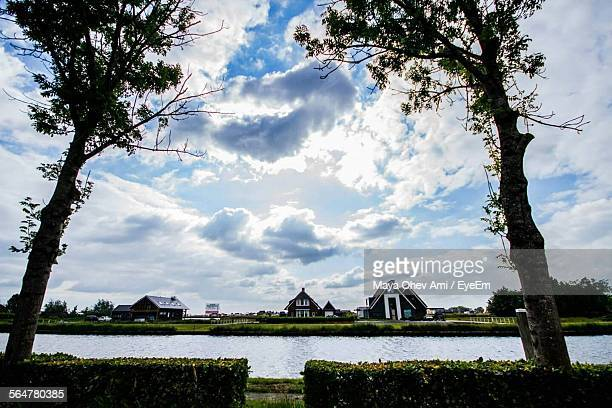 Residential House By River Against Sky In Giethoorn