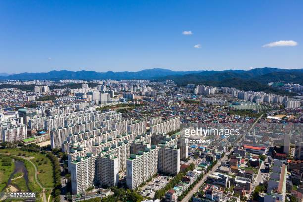 Residential houses and buildings stand in this aerial photograph taken above Jeonju, South Korea, on Friday, Sept. 13, 2019. Relations between Tokyo...