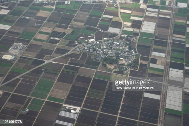 Residential houses and fields in Ozu town in Kumamoto prefecture in Japan daytime aerial view from airplane