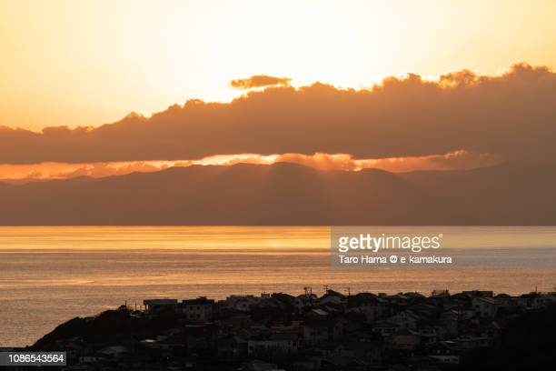 Residential houses by Sagami Bay, Pacific Ocean in Japan in the sunset
