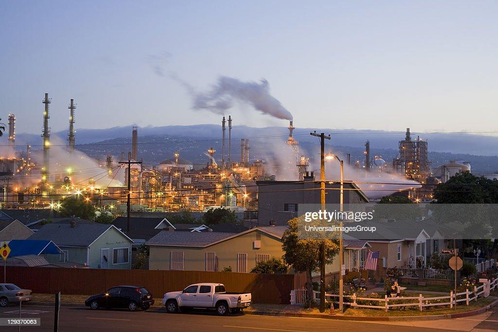 Houses next to oil refinery : News Photo