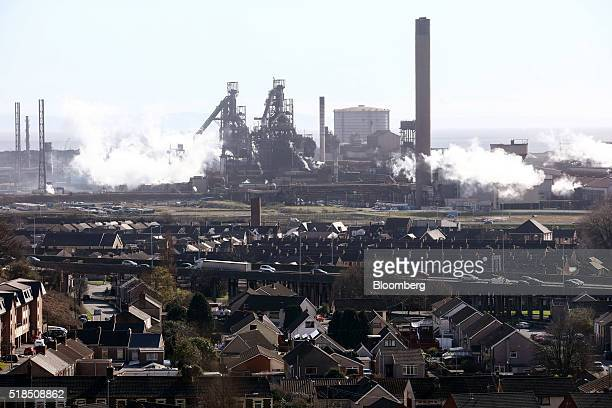 Residential houses stand against a backdrop of the steel works operated by Tata Steel Ltd. In Port Talbot, U.K. On Thursday, March 31, 2016. Tata...