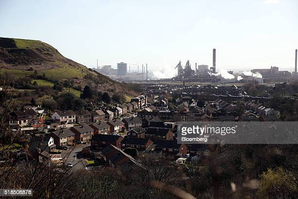 Residential houses stand against a backdrop of the steel works operated by Tata Steel Ltd in Port Talbot UK on Thursday March 31 2016 Tata Steel part...
