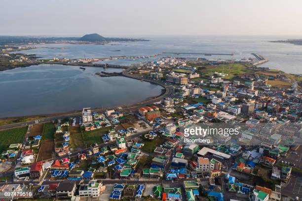 Residential houses stand at Seongsanpo village in this aerial photograph taken above Seogwipo Jeju South Korea on Wednesday June 14 2017 The election...
