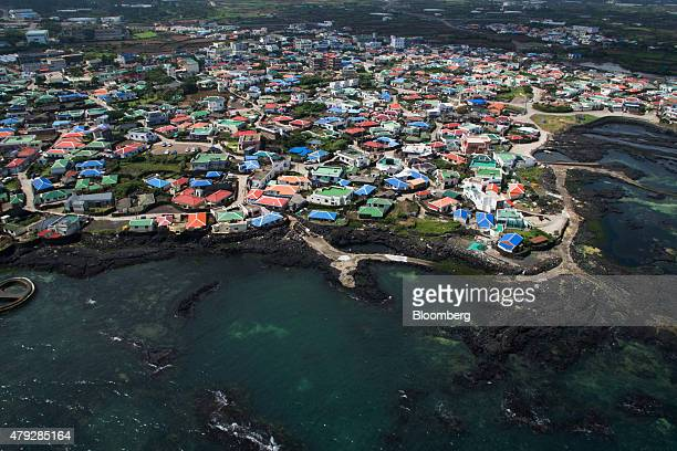 Residential houses stand in the Gimnyeong village in this aerial photograph taken in Jeju South Korea on Sunday June 28 2015 South Koreaâs 15...